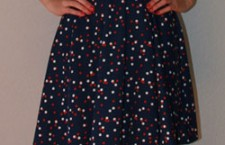 H & M Polka dot dress with patent belt: $29.  Available in stores.